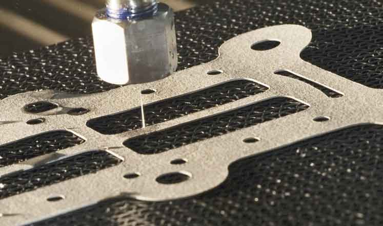 Close up of pure waterjet cutting gasket. Waterjets are versatile. They can cut both soft and hard materials.